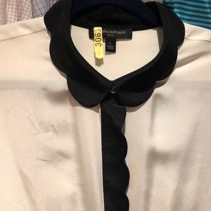 Beautiful ivory blouse with black scallop detail